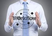 Businessman holding workflow — Stock Photo