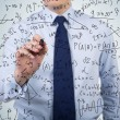 Businessman drawing formulas — Stock Photo #68092925