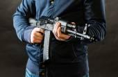 Terrorist holding kalashnikov rifle — Stock Photo