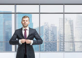 Businessman standing on the office space — Stock Photo