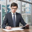 Handsome legal consultant is dealing with due diligence process in a modern skyscraper office with a panoramic Moscow city view. Pages of contract are falling down from the sky. — Stock Photo #70702885