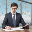 Handsome legal consultant is dealing with due diligence process in a modern skyscraper office with a panoramic New York view. Money are falling down from the sky. — Stock Photo #70703107