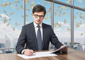 Handsome legal consultant is dealing with due diligence process in a modern skyscraper office with a panoramic New York view. Money are falling down from the sky. — Stock Photo