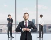 Young professionals are standing in a contemporary glass office in New York. — Stock Photo