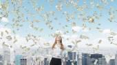 Business woman among flying dollars — Stock Photo