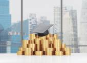 Graduation hat is laying on the coins pyramid. A concept of a high price for the university education. Panoramic lecture theatre background. — Stock Photo