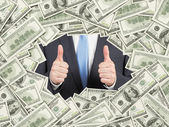 A man with thumbs up inside the US Dollar bills frame. 100 dollar nominal bills both sides. Front and reverse. — Stock Photo