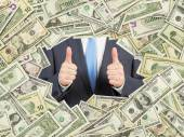 A man with thumbs up inside the US Dollar bills frame. All nominal bills both sides. Front and reverse. — Stock Photo