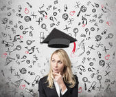 A lady is pondering over the advantages of education. A concept of the further business education. — Stock Photo