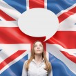 Beautiful woman and the blank speech bubble above the head. Great Britain flag as a background. — Photo #74600265