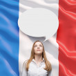 Beautiful woman and the blank speech bubble above the head. French flag as a background. — Zdjęcie stockowe #74600267