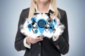 Business woman is holding a cloud with business icons as a concept of successful business management. — Stock Photo