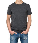 Man wearing dark grey t-shirt isolated on white background. Hands in the pockets. — Stock Photo