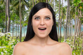 Portrait of an astonished brunette girl. Tropical background. — Stock Photo