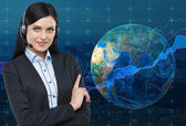 Portrait of brunette support phone operator with the headset. Forex chart over the blue background and the globe as a concept of international finance market. Elements of this image furnished by NASA — Stock Photo