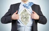 Businessman is tearing the shirt on the chest. Dollar notes under the shirt. The concept of the business soul. — Stock Photo