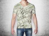 Close-up of a man in a t-shirt crafted from dollar notes. Concrete background. — Stock Photo