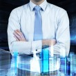 Close up of the businessman with crossed hands. Hologram cityscape on the front view and forex chart on background. — Stock Photo #78890098
