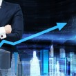 Close up of the businessman with crossed hands. Growing arrow as a concept of the success. Hologram cityscape on the front view and forex chart on background. — Stock Photo #78890106