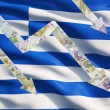 Falling down arrows made of Euro notes over Greek flag. — Stock Photo #78890132