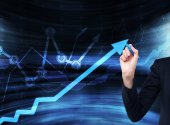 A hand is drawing a growing arrow on the glass scree, Blue dark background with financial graphs. — Stock Photo