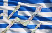 Growing Euro notes arrows over the Greek flag. — Stock Photo