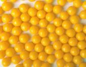 Yellow round pills, as vitamins on white background. — Stock Photo