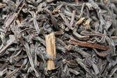 Black tea leaves with bergamot orange zest — Stock Photo