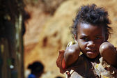 Poverty, portrait of a poor little African girl lost in deep tho — Stock Photo