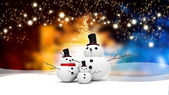 Snowman family with light star — Stock fotografie