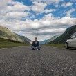 Young man road mountains car — Stock Photo #58242367