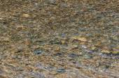 Water waves stones texture — Stock Photo