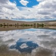 The reflection of the sky and clouds in a lake in the steppe — Stock Photo #58838439