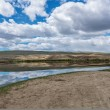 Steppe landscape with a lake, which is beautifully reflected sky — Stock Photo #58838457