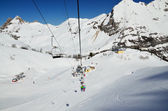 Chair lift above the snow pistes — Photo