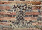 Fragment of the ancient masonry in the modern brickwall — Stock Photo