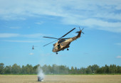 Military helicopter shooting — Stock Photo