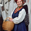 Ukrainian woman in the traditional garment — Stock Photo #64777753