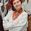 Ukrainian woman in the traditional garment — Stock Photo #64778237