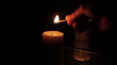 Match lights a candle — Stockvideo