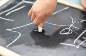 Little hand is drawing on chalk board — Foto Stock