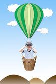 白地、熱気球のバスケットに binoculas の小さな男の子 — ストック写真