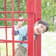 Little boy smiling out off the door — Stock Photo #60511871