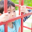 Little boy with sadness face inside the door — Stock Photo #60511899