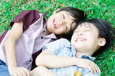 Little boy friends laugh together in the park — Stok fotoğraf