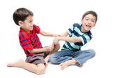 Two happy boys wrestling game tablet in the kids room — Stock Photo