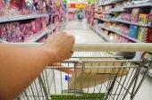 Closeup of woman with shopping cart. — Stock Photo