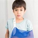 Little boy arm broken using arm sling — Stock Photo #77346216