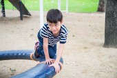 Little boy playing together at playground — Stock Photo
