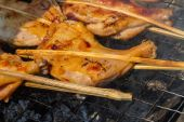 Grilling chicken on charcoal grill — Stock Photo